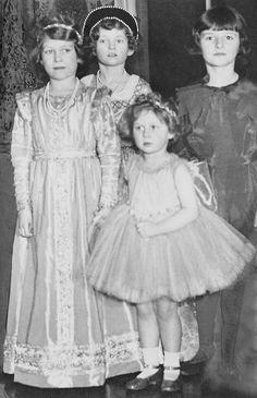 schoolmarmcharm:  Princess Elizabeth and Princess Margaret attending a fancy dress party in 1935.