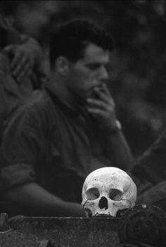 VIETNAM. Human skulls were a favorite souvenir among the soldiers and their officers. The commander of this unit, Colonel (now Brigadier General) George S. Patton III, carried around a skull at his farewell party. 1967
