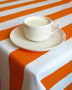 Orange is the New Black, stripes, striped tablecloth, coffee, orange and white, white coffee mug