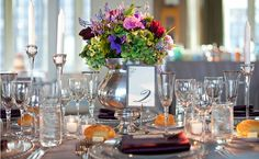 Don't underestimate an absence of color. Crystal and silver accents -- like at this reception -- make the floral centerpieces really pop and make the rest of the table look extra-elegant and refined. #tablescape #glassware