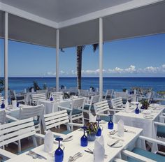 Jamaica Inn's open-air restaurant with views of the Caribbean Sea. http://jamaicainn.com/dining.php
