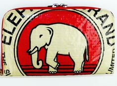 Fair trade wallet made by Cambodian trafficking survivors from recycled cement bags with an elephant design.