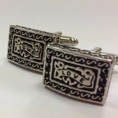 A pair of 'love' black n silver toned stainless steel cufflinks.  Approx. 13 x 20mm.  Priced at $58.
