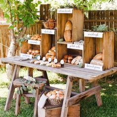 A bread stand featuring artisan breads, croissants, potato rolls, and assorted cheeses, served in wooden crates, styled by The TomKat Studio for Real California Milk.