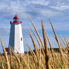 Lighthouse on Miscou Island New Brunswick in Canada. Typical of lighthouses on Canadas East Coast this one guides shipping heading for the St Lawrence River.