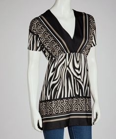 <p+style='margin-bottom:0px;'>Designed+to+dazzle+and+flatter,+this+tunic+boasts+a+pretty+print+and+a+slimming+empire+waist+cut+for+a+look+that+elevates+the+confidence+of+any+ensemble.<p+style='margin-bottom:0px;'><li+style='margin-bottom:0px;'>Measurements+(size+S):+31''+long+from+high+point+of+shoulder+to+hem<li+style='margin-bottom:0px;'>95%+polyester+/+5%+spandex<li+style='margin-bottom:0px;'>Hand+wash;+hang+dry<li+style='margin-bottom:0px;'>Made+in+the+USA<br+/>