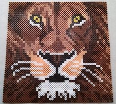 "Lion Animal Art - African Home Decor - Perler bead art (9.75""x9.75"") by TheAbsity - Pattern: http://www.pinterest.com/pin/374291419003177085/"