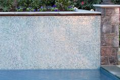 Check out more design and flooring ideas at www.carolinawholesalefloors.com or our Facebook page! iridescent mosaic pool wall