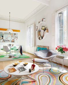 Colorful Apartment Ideas from Barcelona. That wall hanging thing would be awesome for CDs and DVDs.