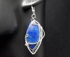 A delicate, unique, handmade, wire wrapped earrings with Lapis Lazuli. Earrings were designed and made by Me, using an extremely labor-intensive and precise wire-wrapping technique, with silver 925, 930 and 999.  Dimensions of earrings: length: 5.8 cm (2.28 inch) width: 2.5 cm (0.98 inch)  You receive these unique earrings in jewelry box, so theyre ready to be a gift.   Refunds and Exchanges:  If you are not satisfied with your purchase for any reason, please contact me before leaving a…