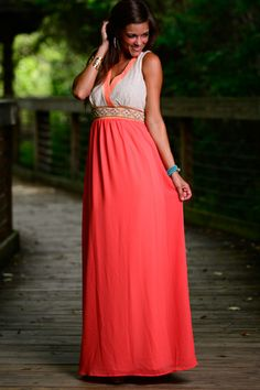This romantic orange maxi is leaving us speechless! The relaxed feel with the beautiful embroidery waistline is amazing!