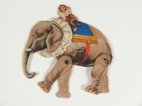 Moveable circus figure of a monkey riding an elephant
