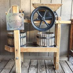 Check out this #farmhouse porch decor idea with vintage farmhouse equipment. Love it! #HomeDecorIdeas @istandarddesign