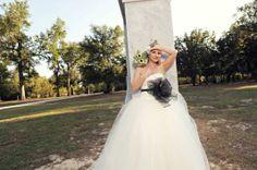 DB #bride Ashley Wearing White by Vera Wang  Ball Gown with Asymmetrically Draped Bodice Style VW351007 paired with White by Vera Wang Sash Style VW370034 in Ebony #davidsbridal #weddings #realweddings
