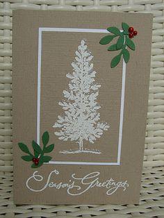 I like the white embossed tree & neutral background.