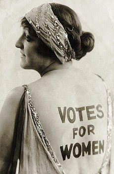 "Dorothy Newell, an outgoing young woman with a sense of humor, promotes women's enfranchisement by wearing the words ""Votes for Women"" emblazoned on her back. Suffragists tirelessly publicized their cause in more conventional print forms, churning out banners, flyers, posters, articles, and newspapers © Underwood & Underwood/Underwood & Underwood/Corbis."
