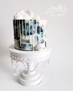 Navy and white drip cake. By Jenelle's Custom Cakes.