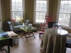 A sun room made of of funky furniture makes for the perfect reading escape...
