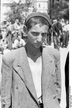 July 1942, Thessaloniki, Greece: Portrait of a young Jewish man being pressed into forced labor by the Germans. By the end of the following year, the entire Jewish population of Thessaloniki had been deported to Auschwitz.