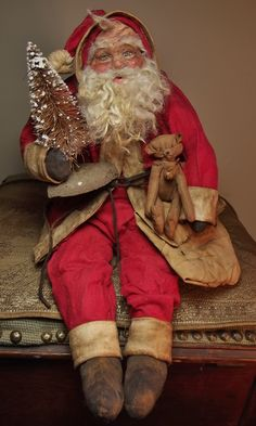 Handmade Sitting Primitive Very Grubby Old SaNtA KlAuS~By Kim Sweet~Kim's Klaus ....I found an old head...that I made years ago... I could tell right away...it was someone I know... His age wouldn't wipe off...so I just let it Be.... Then made him a Red Suit-a Teddy & gave him a Tree....