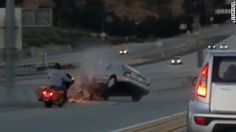A road rage wreck caught on camera shows an altercation with a motorcycle and a car that resulted in a SUV flipping on the highway.
