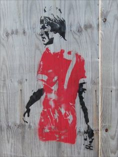 A Banksy style painting of Liverpool FC manager Kenny Dalglish on a hoarding opposite the club's Melwood training ground.