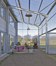 A rural barn house with a polycarbonate sunroom