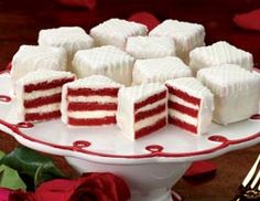 "Red Velvet Petits Fours ○ ""Three layers of moist, luscious red velvet cake separated by creamy vanilla icing."""