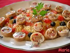Cuscus de calamares rellenos. Ver Receta: http://www.mis-recetas.org/recetas/show/36068-cuscus-de-calamares-rellenos