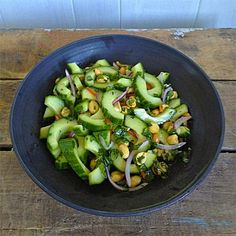 Thai Cucumber Salad with Peanuts | In this refreshing salad, crisp cucumbers and aromatic cilantro are tossed with a tangy dressing made with lime juice, fish sauce and fiery Thai chiles.