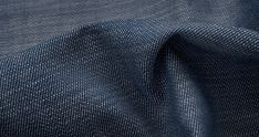 Denim Shirting Fabric. Denim is made with a colored yarn in the warp and white in the weft, but is woven in a twill construction.