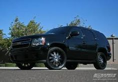 Black on Black Tahoe.....we do it for the ratchets ^__^