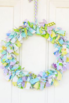 DIY Shabby Chic Fabric Wreath - Perfect for a wedding, this colorful spring craft can be made with scrap fabric.