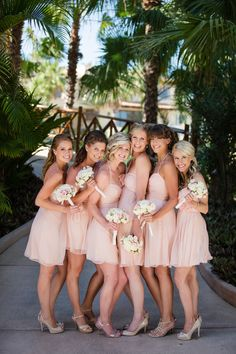 Flirty short pink bridesmaids dresses by Amsale. See the wedding on SMP: http://www.stylemepretty.com/destination-weddings/2014/02/20/cabo-san-lucas-wedding/ Amy Bennett Photography