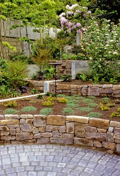 Stone Flower Bed : Stone wall flower bed. Imagine with blooming flowers and lush green ...