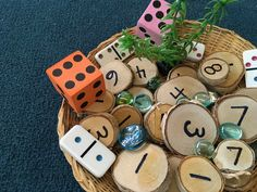 Reggio Math Basket for student Number Investigations using wooden number discs, dice, dominoes and loose parts at Chicago's innovative Bennett Day School (via Bennett Day School)