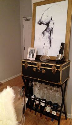 My fab new (thrift store find) bar!  Trunk: $4  Wine Rack: $12  Picture purchased online and printed at Office Depot: $15 + $3