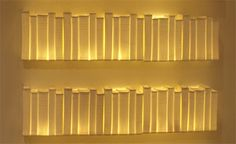 """""""scrinium"""" (bookshelf in latin"""" is a ceramic light made from bone china. it can be placed on a bookshelf or as a work of art onto the wall."""