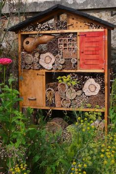 Insect house and bee colony on the grounds of the Potager du Roi, where the original gardens date back to the reign of Louis XIV (1678). The King's gardens were located near his palace in Versailles where he would show off his abundant produce and espaliered fruit-bearing trees.