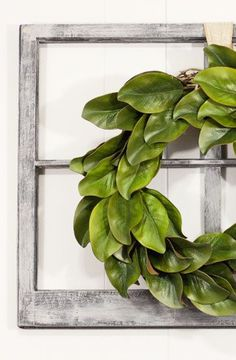 a gorgeous but thrifty diy magnolia wreath. It looks beautiful hanging on that vintage window.What a gorgeous but thrifty diy magnolia wreath. It looks beautiful hanging on that vintage window. Magnolia Wreath, Magnolia Leaves, Sweet Magnolia, Vintage Windows, Antique Windows, Diy Wreath, Wreath Ideas, Wreath Making, Burlap Wreaths