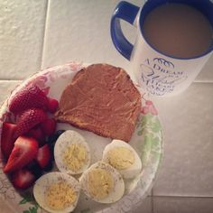 yummy meal- hard boiled eggs, strawberries and peanut butter toast