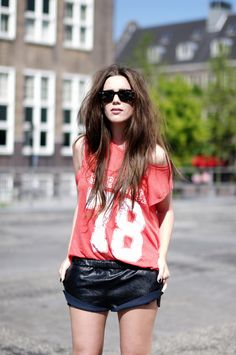 Gotta love a sports tee. The leather hotpants are an awesome touch, too!