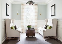 """This cozy seating area boasts gray blue paint (""""Benjamin Moore Woodlawn Blue"""" ) on upper walls and stacked wainscoting on lower walls. Linen, wingback settee adorned with green velvet Woodlawn Blue, Luxury Interior Design, Luxury Home Decor, Luxury Homes, Brown Pillows, Blue Pillows, Velvet Pillows, Family Room, Home And Family"""