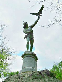 """The Falconer"" (1875), bronze statue by British sculptor George Blackall Simonds (1844  – 1929), in Central Park, New York City. May 2, 2014."