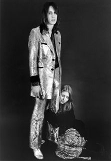 Singer / songwriter genius Todd Rundgren with the chanteuse of the NYC punk scene (and Liv Tyler's mom), Bebe Buell. Everybody wanted Bebe - Mick Jagger, Jimmy Page, Iggy Pop, Johnny Thunders... Steven Tyler got together with her just long enough to father Liv before dissappearing down a drug hole for a decade or so while Todd raised Liv - proving that sometimes the geeky guy gets the hot girl, even with all those cock-rock gods circling. Todd Rundgren was never a huge star, and he never…