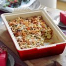 Try barefoot Contessa's Leek and Artichoke Bread Pudding Recipe. Says you will never go back to regular stuffing again. This one looks good!