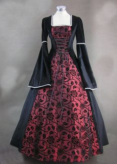 I would LOVE IT if someone would buy or mke me a custome dress like this!! pretty please?!?! Ladies Medieval Renaissance Costume And Headdress Image