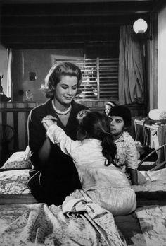 graceandfamily:  Princess Grace with Monaco's orphans. 1962.