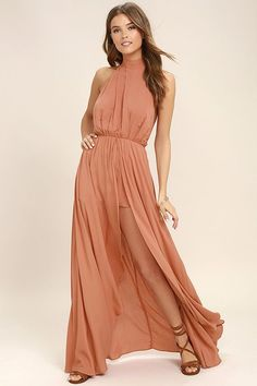 Escape into your own private lagoon in the Secret Hideaway Terra Cotta Halter Romper! Woven rayon sweeps across a tying halter bodice and elasticized open back. A maxi skirt with front slit tops fluttering shorts for a bold finish.