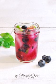 Blueberry Mojito:  1 tsp granulated sugar  4 large leaves of mint, fresh  1/4 lime  1 1/2 oz blueberries  2 oz rum, white  1 cup ice  2 oz club soda